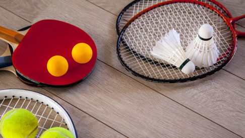 items-fitness-racquets-accessories-badminton-table-tennis-tennis-wood-background_96540-7.jpg